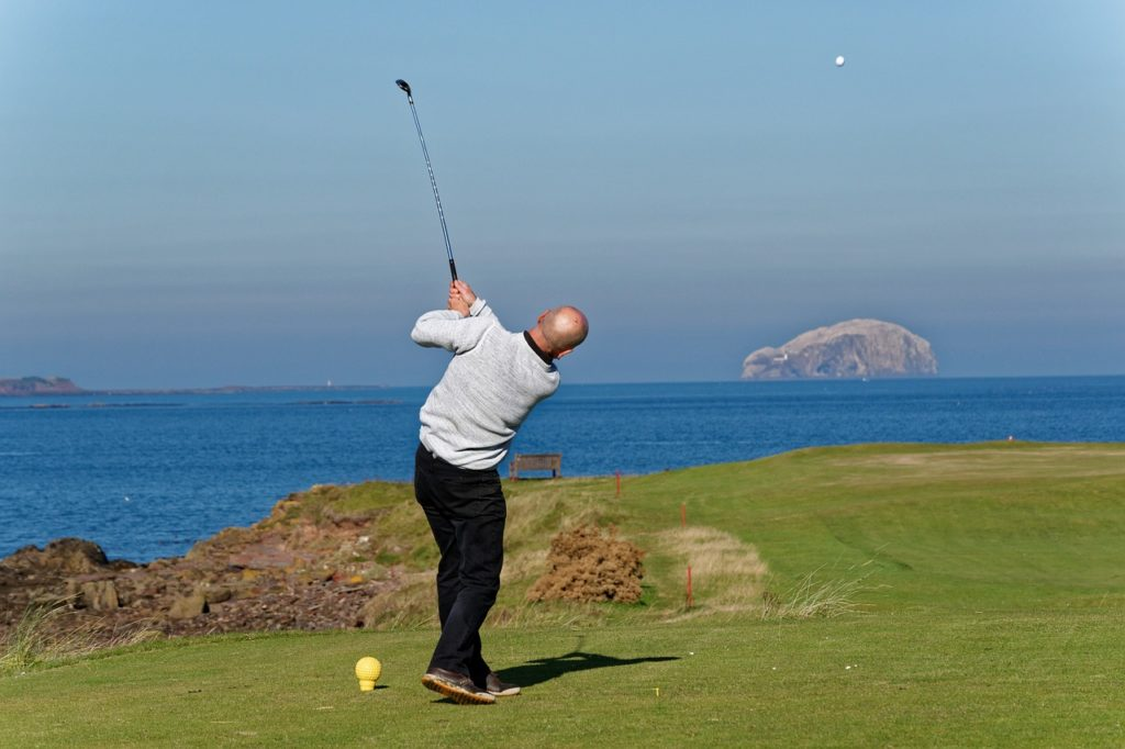 Golfer Tees off in Scotland